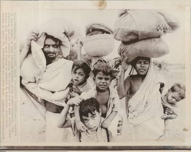 Refugees from East Pakistan During Bangladesh Liberation War 1971  Meherpur, East Pakis April 22 - Seeking Safety - With bundles on their heads, on East Pakistan refugee group leaves Meherpur, East Pakistan seeking safety in India. The refugees had to seek safety after Bangla Desh rebels were forced to retreat by Pakistani government troops on April 19 1971