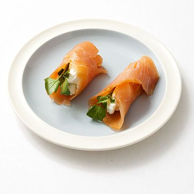 2 Creamy Salmon Rolls. 74 calories.   For each roll: Wrap 1/2 ounce smoked salmon around 2 teaspoons 1/3-less-fat cream cheese and 1 watercress sprig