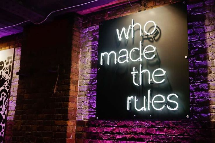 'Who made the rules' Neon sign
