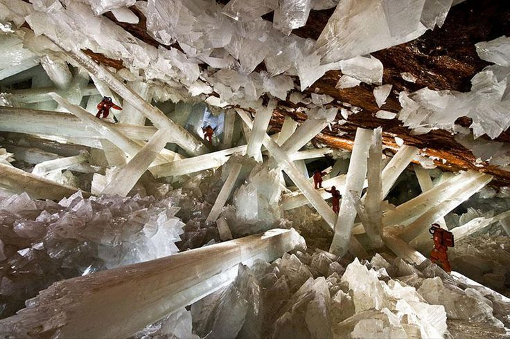 "Naica Mine  ""This silver mine is coated in crystals as big as 50 feet long and 4 feet wide. Hydrothermal fluids formed them by rising from the magma chambers below."""