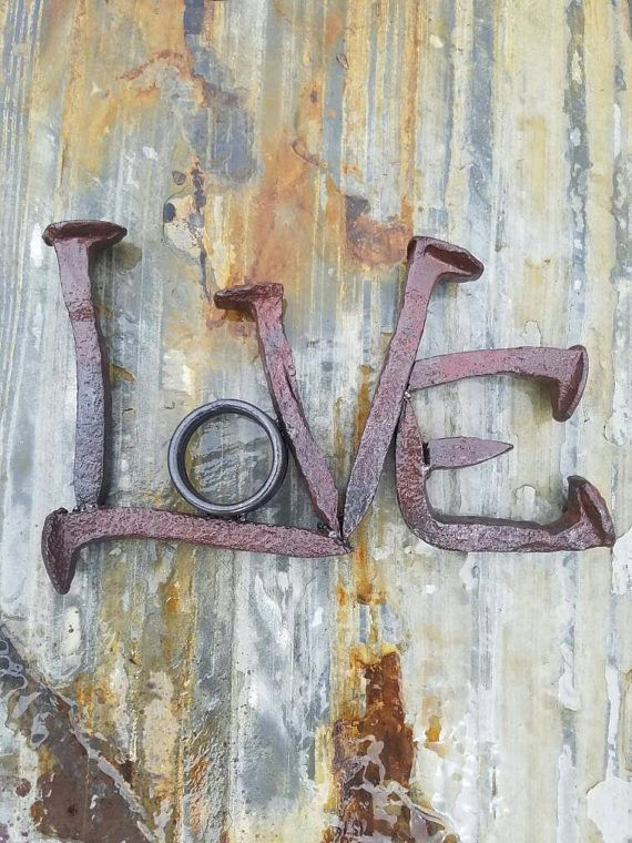 Check out this item in my Etsy shop https://www.etsy.com/listing/522281297/love-word-art-railroad-spike-art-metal