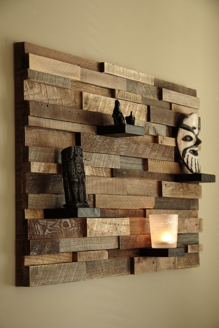 Barn wood is allowed to really show it's character in this reclaimed wall art piece and shelf by carpenter Craig Forget.
