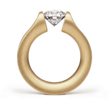 Everest Tension Ring by Niessing: The diamond marks the summit that crowns the evenly arching ring band.  18k yellow gold set with .50ct round diamond. Available from www.davidsonjewels.com