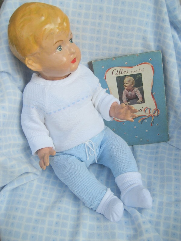 Wildebras doll with vintage book