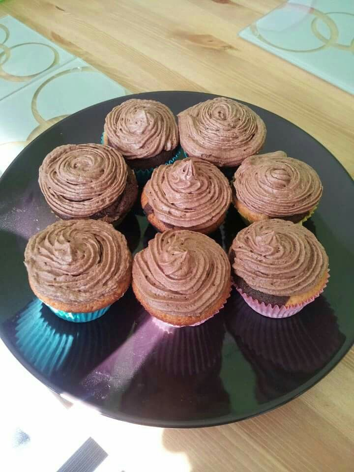 Vanilla and chocolate swirled cupcakes topped with chocolate buttercream