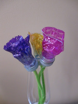 Calla lilies crafted out of recycled water bottles for Water bottle recycling ideas