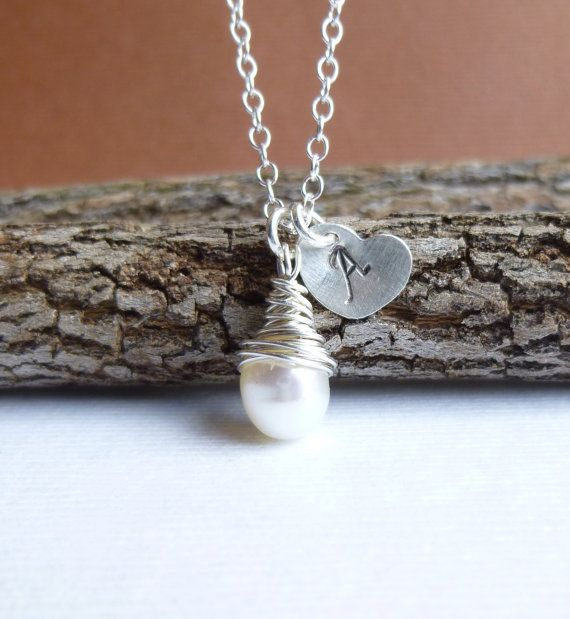A delicate 6mm pearl briolette has been wrapped with sterling silver wire and hangs next to a petite (8mm) heart. The heart has been hand
