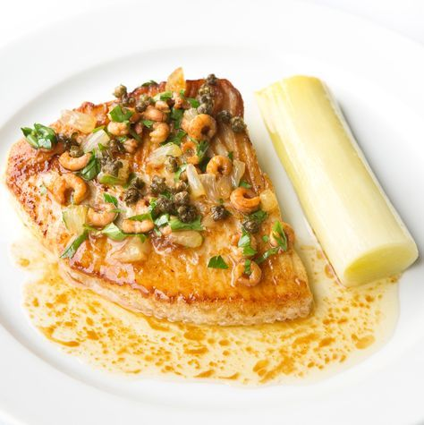 Taken from the menu of Bryn William's coastal restaurant, Porth Eirias, this delicious skate wing recipe showcases how well simple flavours can marry together to make a spectacular dish, as the leek is as much a hero as the skate. Lemon, capers and shrimp cut through the rich butter sauce, while the leeks are served whole, but are deliciously tender from being braised in a foil parcel.