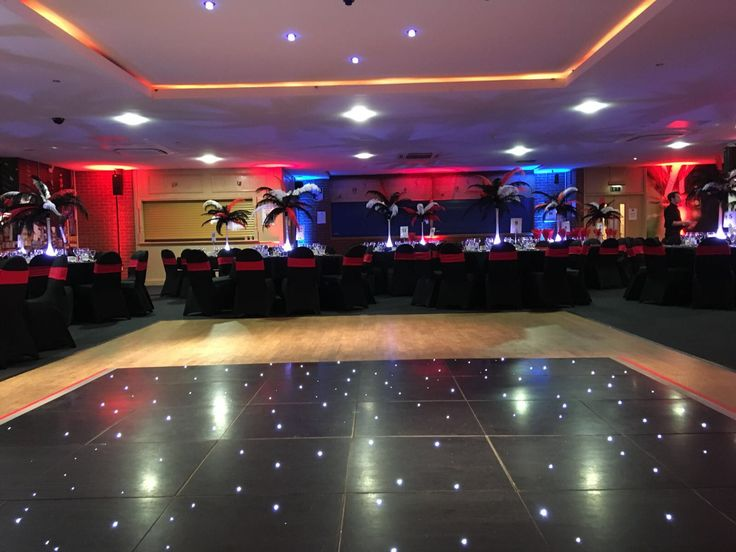 The bright and inviting function room with fairy-lit dancefloor, uplighters and spotlights