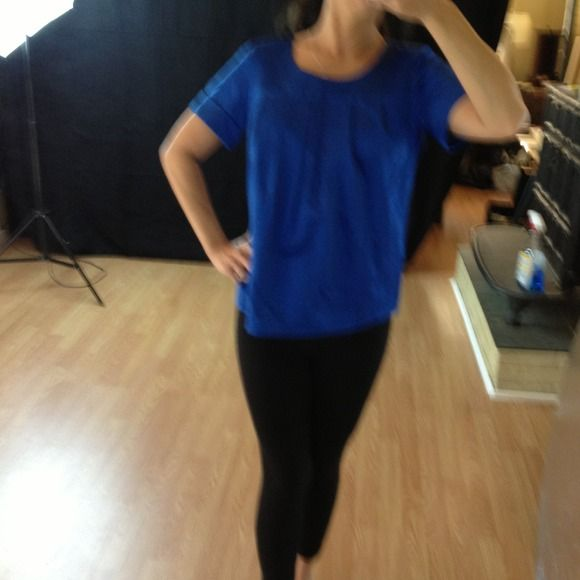MICHAEL KORS blue short sleeve top Short sleeve top. Pleated on top. Fuller at the bottom. Beautiful blue coloring. Michael Kors Tops