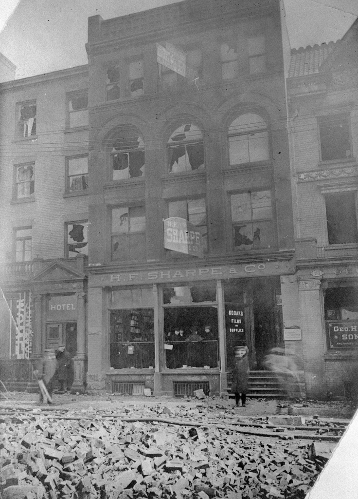 Aftermath of the Great Toronto Fire (April 19, 1904): The east side of Bay St., between Wellington and Melinda Streets. This image shows the photographic goods store of Henry Fowlds Sharpe, the photographer who took most of the 1904 fire shots that we display here.