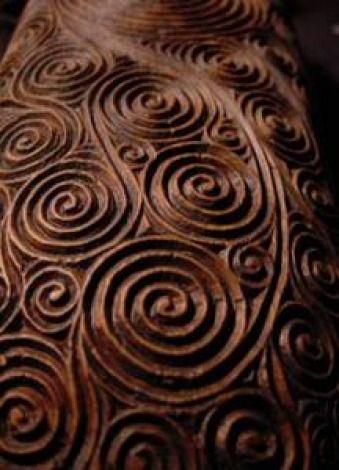 Maori feather box with a fern-fiddlehead motif