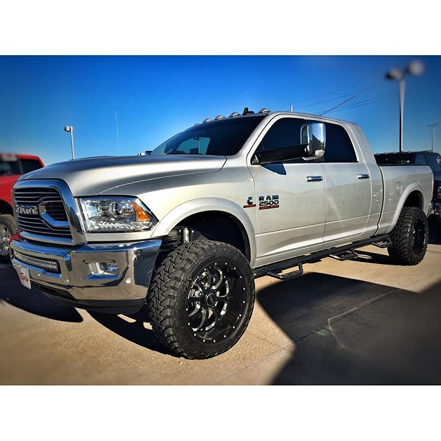 2016 Peters Elite Ram 2500 Mega Cab Laramie , Level kit w fox shocks front and rear , 22 inch BMF wheels, 35 inch tires , 40 inch curved rigid, nfab steps , limited grille,