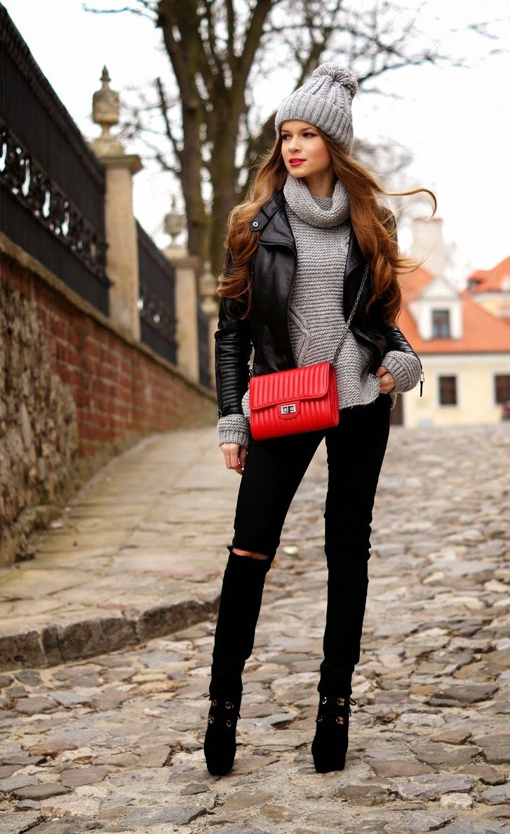 Winter outfit: grey knit hat, black leather biker jacket, grey turtleneck sweater, black distressed jeans, black booties, red bag