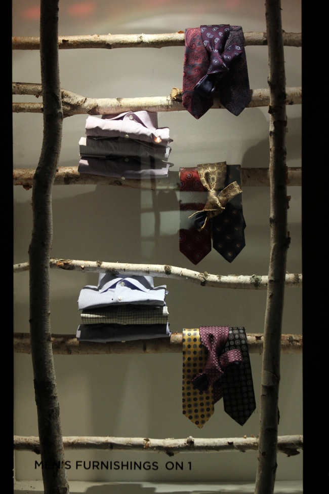 Shelving.  Actually this is labeled as shelving but I believe it's a store display. Otherwise it's just the cheapest and least practical way to store your clothes. Unless you are a beaver and all those shirts get worn at the same time so you can wedge them back in together.