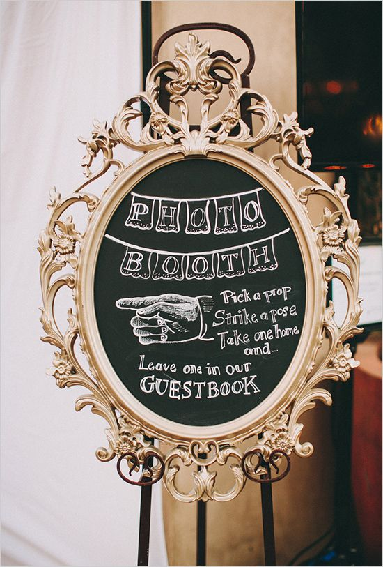 Photo booth chalkboard sign. Captured By: Lauren Scotti Photography http://www.weddingchicks.com/2014/06/06/shabby-chic-plaza-wedding/