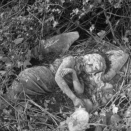 A statue of a sleeping angel in Highgate Cemetery  John Gay:Photographer      Photographer: John Gay
