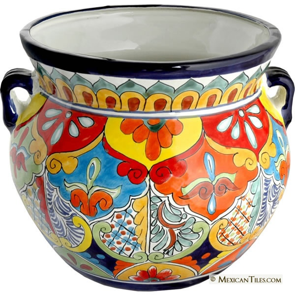 Painted Mexican pottery for front downspout voids.