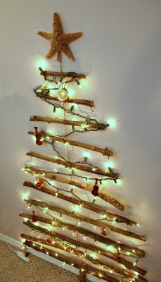 Christmas branch tree on the wall - Turtles and Tails blog  Thinking this might work well in our living room this year.