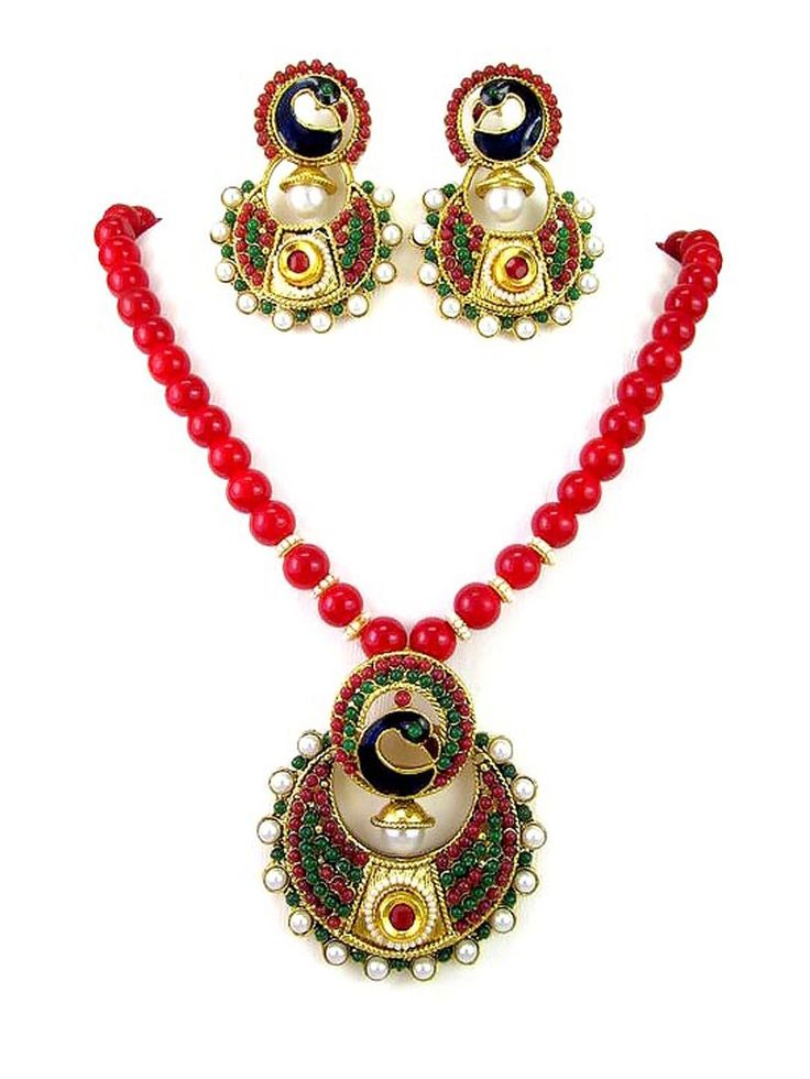 Gold plated brass metal #Pendant with pearls, mina work and paired with matching #Earrings. Item Code ; JPD82092  http://www.bharatplaza.com/new-arrivals/jewellery.html