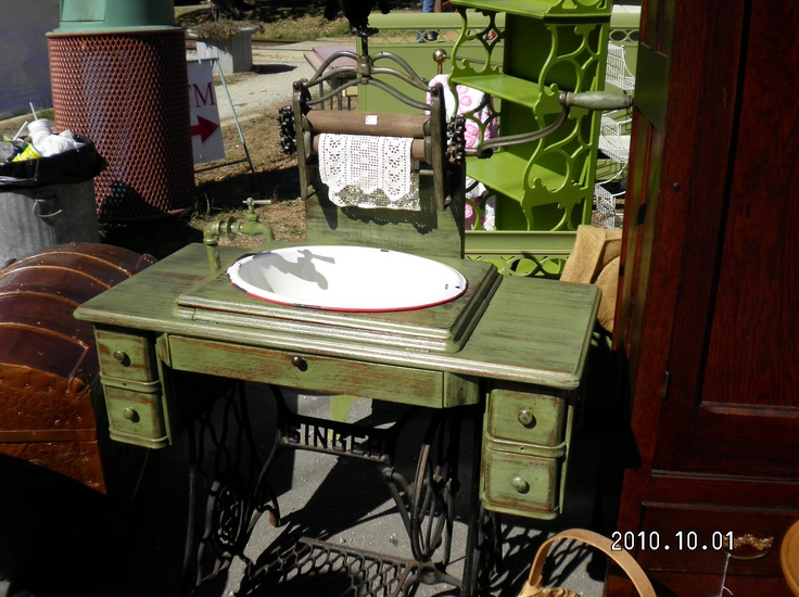 Cool use for an old sewing machine cabinet!