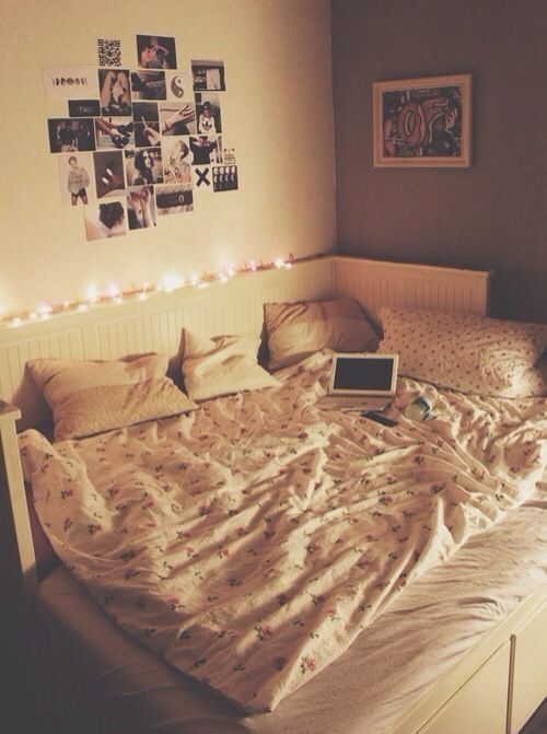 The cream colours✌️ fairy lights✨ and the pictures on the wall also big bed with flowery duvet//nice bedding