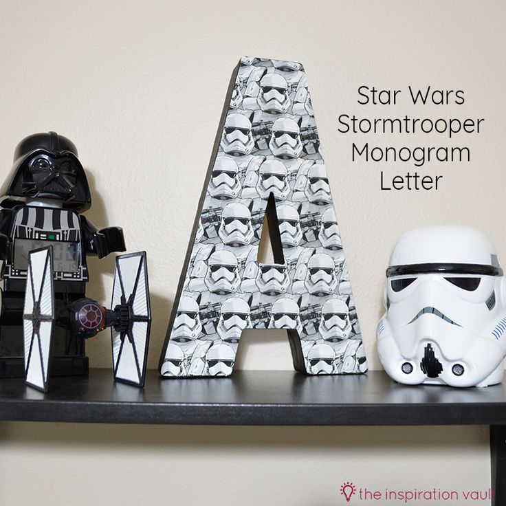 Learn how to make this Star Wars Stormtrooper Monogram Letter for your little Jedi using wrapping paper, Mod Podge, and a canvas monogram letter.