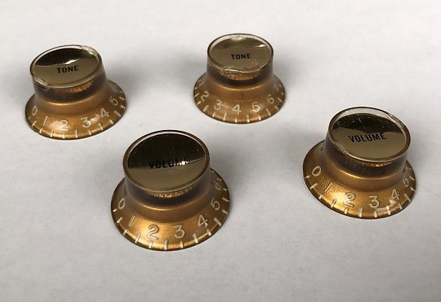 Ref# P0002: This is a beautiful set of Gibson Gold Reflector knobs with gold foils. They are in good condition for their age and are a bit hard to find. Use these on your early 60's Gibson ES-330, ES-335, ES-345, ES-355! In our over 30 years of business, Customer Service has always been of the utmost importance to us. Every call, email and inquiry will be answered. We are happy to offer full descriptions of condition and sound of all of our instruments to the best of our expertise. PLEASE NO