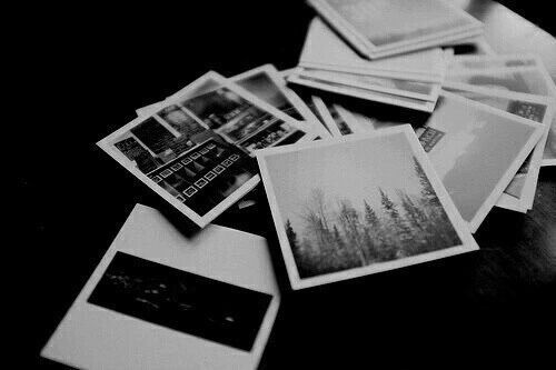 She looks at the polaroids of his travel. Places.. People..Food. What luxury. What a wonder this world is.