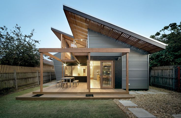 A period home in Melbourne, named the Nest House, was extended to include an open living space and mezzanine, along with a partially covered outdoor space.