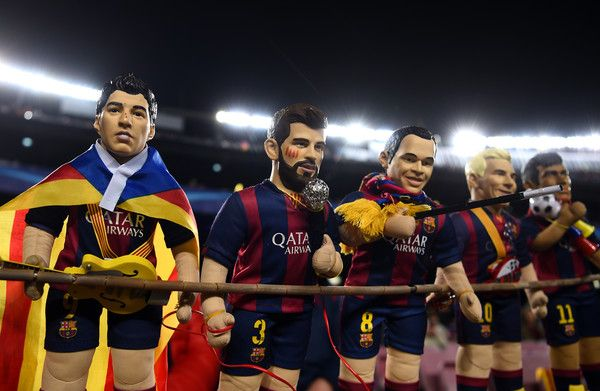 Dolls of Luis Suare,Gerard Piquet, Andres Iniesta, Lionel Messi and Neymar of Barcelona are seen prior to the UEFA Champions League Round of 16 second leg match between FC Barcelona and Paris Saint-Germain at Camp Nou on March 8, 2017 in Barcelona, Catalonia.