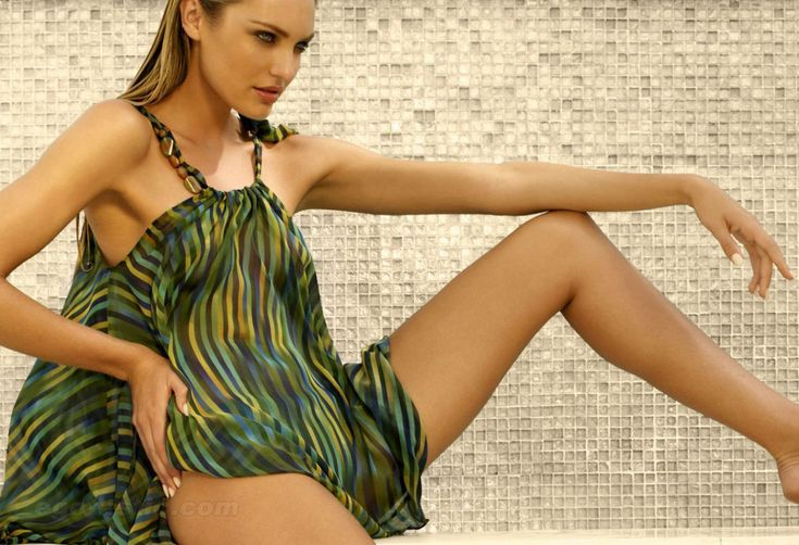 Candice Swanepoel poses  for the Turkish Zeki Triko swimsuit line