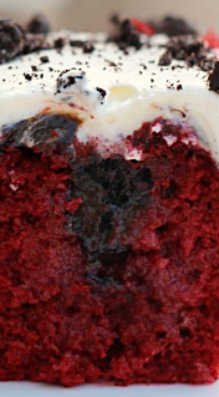 Red Velvet Oreo Poke Cake ~ An easy and decadent red velvet poke cake that is filled with sweetened condensed milk, hot fudge and Oreos. It is topped with a cream cheese whipped cream icing.