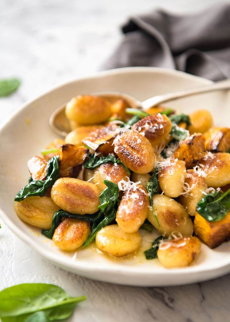 Pan fried gnocchi - golden crispy on the outside, soft on the inside! Tossed with roasted pumpkin, spinach and a buttery sauce. Easy to make, so delicious!