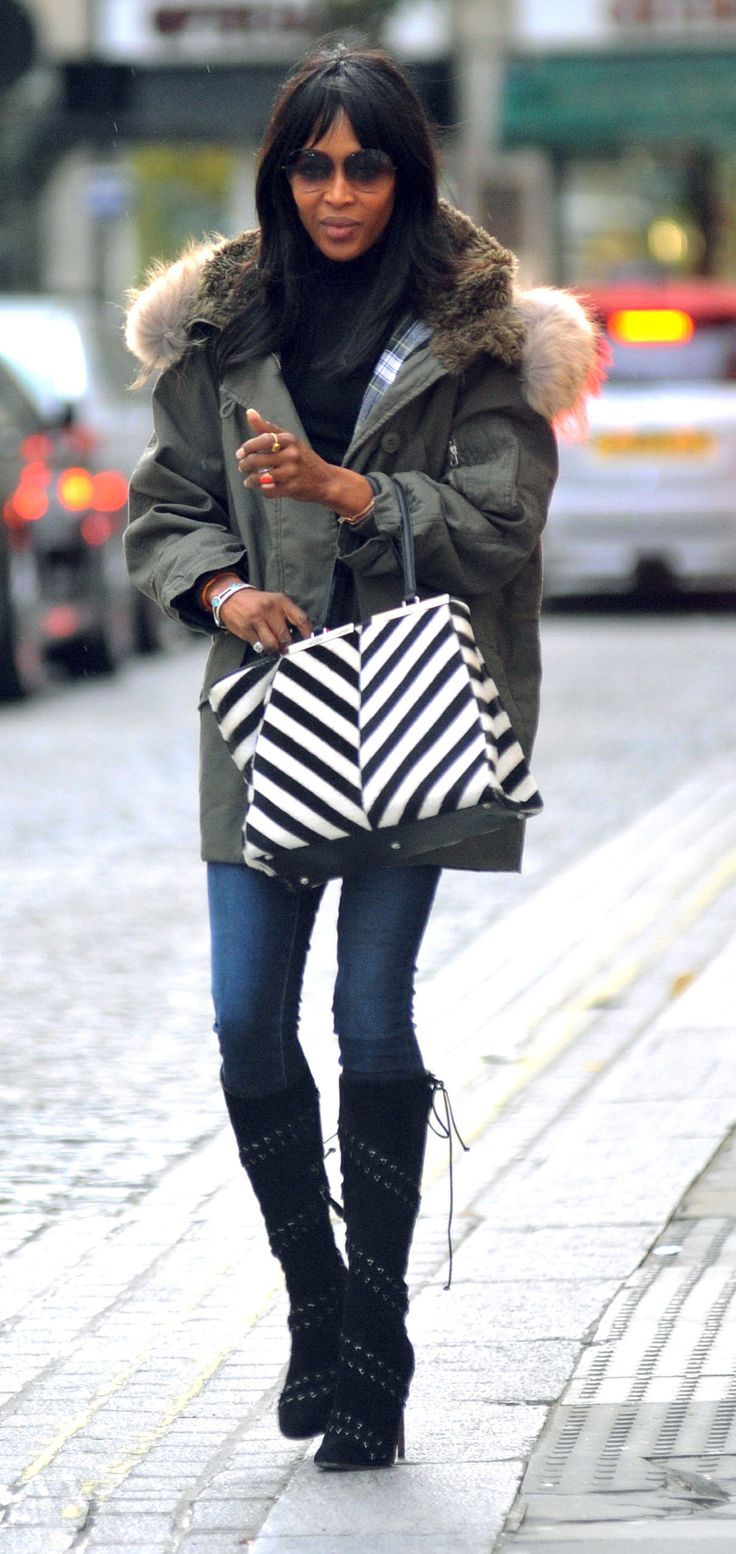 Naomi Campbell walks in London with her striped Fendi Fall/Winter 2014-15 3Jours bag
