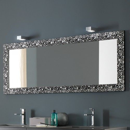 The antique floral pattern of the mirror frame creates an interesting contrast and provides a striking focal point to ordinary bathroom walls. http://www.ybath.com/azzurra-riccioli-horizontal-mirror.html