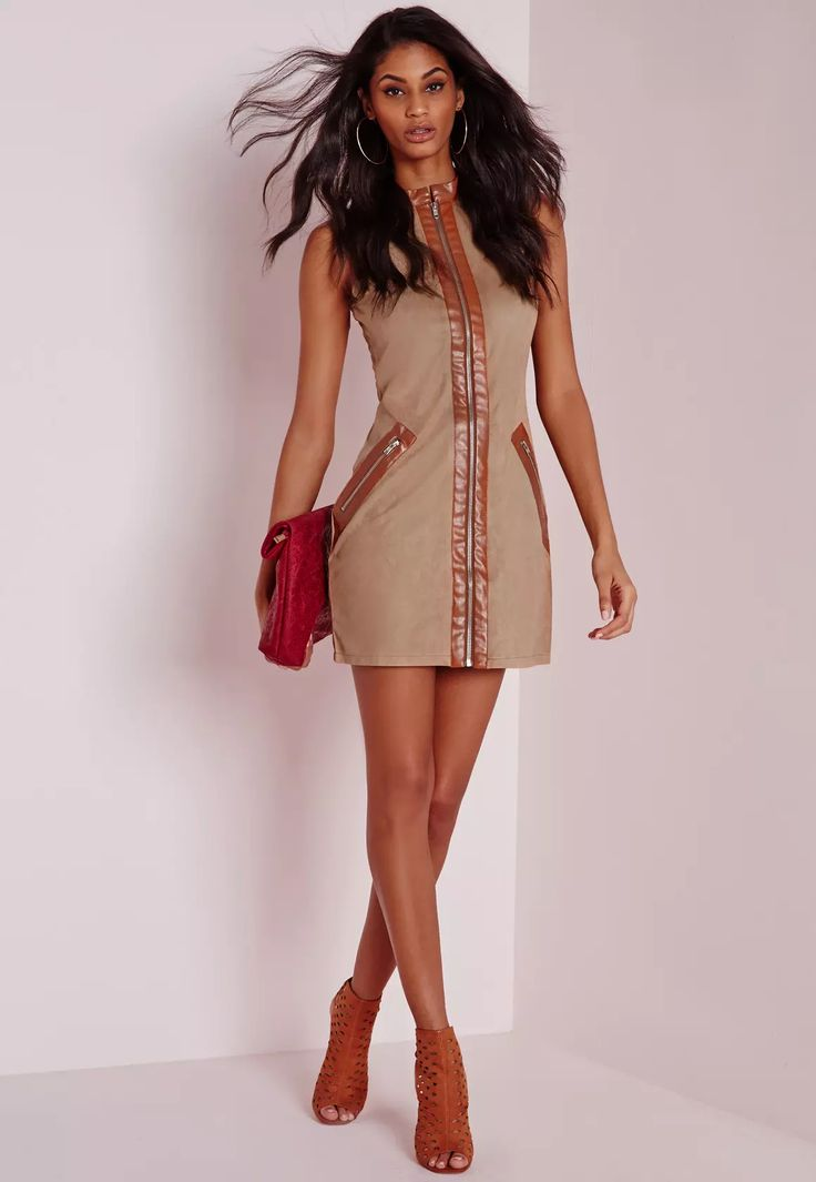 Up your day game in this fierce nude suedette mini dress, were in love with this kickass shift dress and vote it a totally wardrobe need this season. The faux leather detailing to the collar middle and zips is seriously on fleek and a perfe...