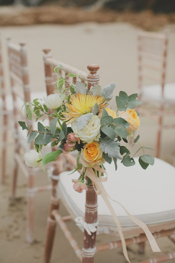 flowers tied to the chairs down the aisle // photo by Ryder Evans // http://ruffledblog.com/bohemian-byron-bay-inspiration
