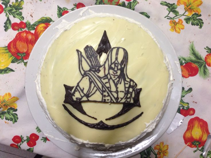 Assassin's Creed cake ...  Chocolate sponge with a chantilly cream and chocolate chips, covered with cream and topped with white chocolate and dark chocolate.