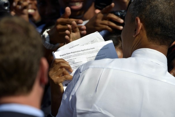 96 Obama on the campaign trail in Wisconsin  The president rallied supporters in Milwaukee.  Sept. 21, 2012    An Obama supporter shows off her Virginia voter-registration form to the president.    Marvin Joseph / The Washington Post