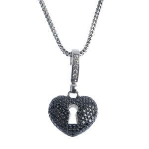 LOT:382 | THEO FENNELL - an 18ct gold diamond and 'black' diamond heart pendant.