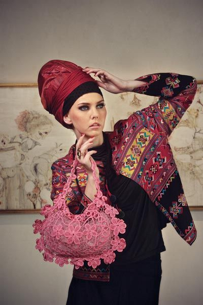 Timorese-design jacket and black Lycra harem pants by Ghea Panggabean. Red row silk headwear by Deden Siswanto. Pink floral motif crochet handbag by Lenny Agustin. Square stone ring and maroon crystal ring by Elizabeth Wahyu. Black Lycra mock-turtleneck from Aquila Asia wardrobe.