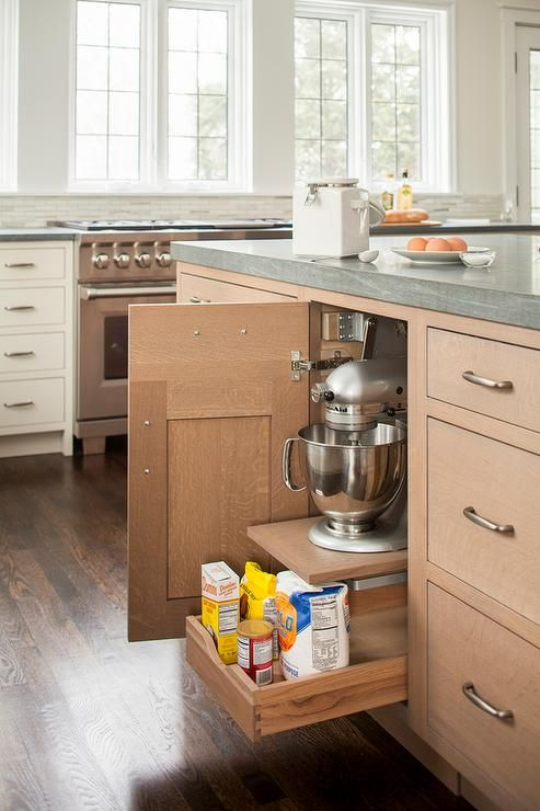 you need to have a big kitchen to give up this much space  to store a KitchenAid mixer, but  if you do, it's a great way to do it!