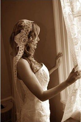 MANTILLA veil            ---  Loose in structure and draped over the bride's head and shoulders like a scarf, this veil is worn without a headpiece and is typically edged in lace.