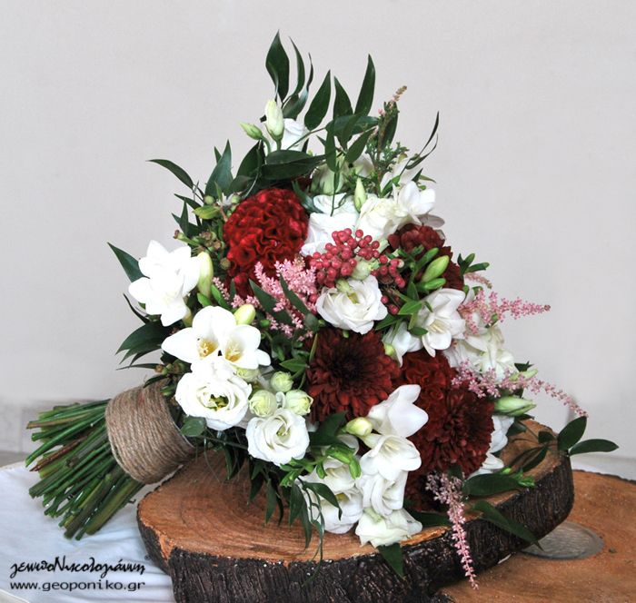 bridal bouquet in burgundy colours, white and a splash of pink