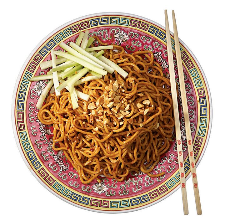 1 pound Chinese egg noodles (1/8-inch-thick), frozen or (preferably) fresh, available in Asian markets     2 tablespoons sesame oil, plus a splash     3 ½ tablespoons soy sauce     2 tablespoons Chinese rice vinegar     2 tablespoons Chinese sesame paste     1 tablespoon smooth peanut butter     1 tablespoon sugar     1 tablespoon finely grated ginger     2 teaspoons minced garlic     2 teaspoons chili-garlic paste, or to taste     Half a cucumber, peeled, seeded, and cut into 1/8-inch by 1