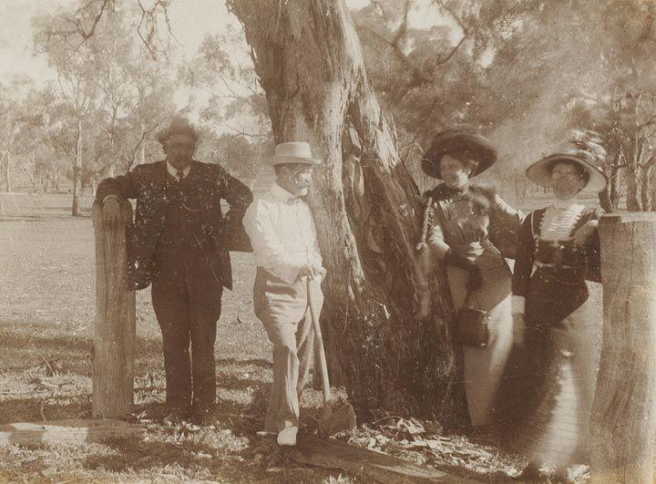 Photographs of Edmund Milne standing next to Aboriginal Arborglyphs [carved trees], Gamboola, near Molong