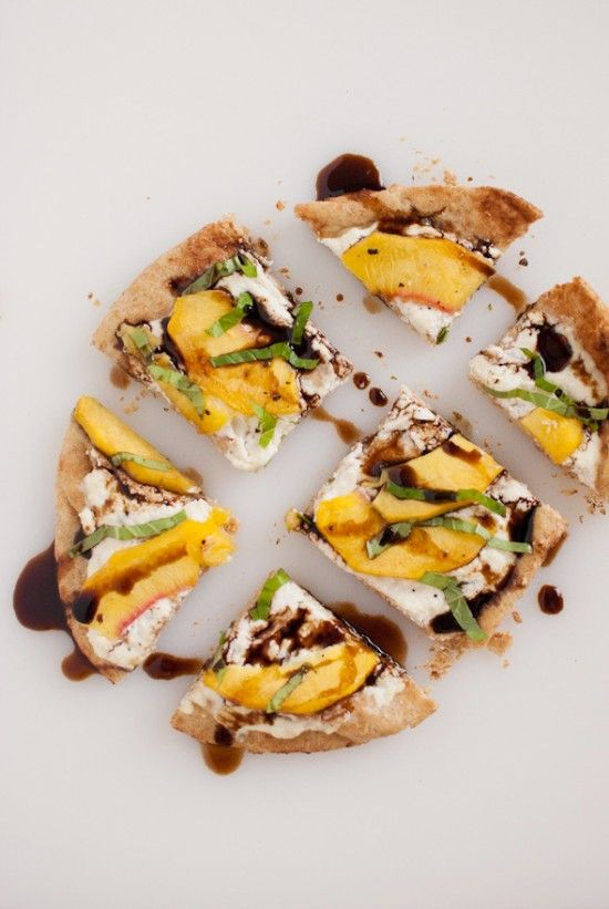 Beautiful, delicious Simple Peach, Basil and Ricotta flatbread. Add a glass of Pinot Grigio, and it's almost Summer.