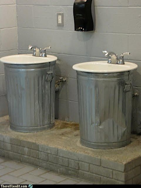 Neat bathroom idea. The cans just hold up sinks and cover the pipes.
