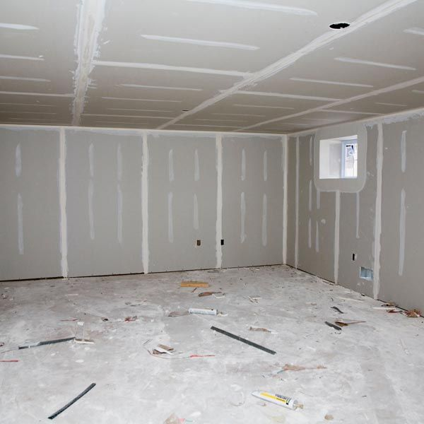 You can use an acrylic-based concrete sealer to treat the slab in the basement, then top-coat it with a commercial grade acrylic paint specially formulated for floors. Check with your local paint store and tell them you want the best product for the job. Skimp on price and you'll only wind up making more work for yourself in the future.